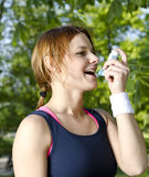 Young girl with asthma inhalator Stock Photos