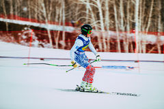 Young girl athlete finish after downhill from mountain during Russian Cup in alpine skiing Stock Photography
