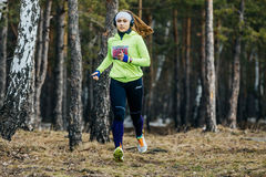 Young girl athlete running in a spring forest Stock Photography