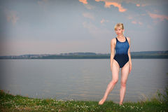 Young girl in athletic swimsuit Stock Images