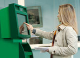 A young girl and an ATM Stock Images