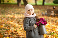 Young girl with autumn bouquet in a watering pot Stock Photography