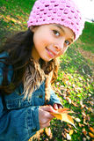 Young girl with autumn leaves Stock Photo