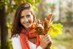 Young girl with autumn leaves in hands Stock Images