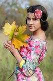 The young girl in autumn park Stock Photos