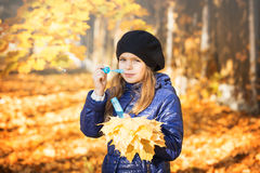 Young girl in autumn park Stock Image