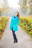 Young girl in the  autumn park in the early morning Royalty Free Stock Photography