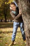 Young girl in autumn park Stock Photos