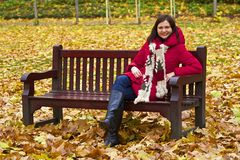 Young girl in the autumn park in London Royalty Free Stock Images