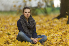 Young girl in autumn Park. Sorrow. Royalty Free Stock Image