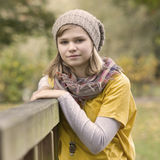 Young girl in the autumn park Stock Photos