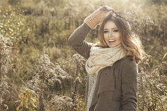 Young girl  in autumn scenery Stock Photo