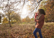 Young Girl On Autumn Walk With Mother Stock Photo
