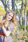 The young girl in autumn wood Royalty Free Stock Photography