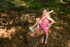 Young Girl with Ax at Chopping Block Stock Photography