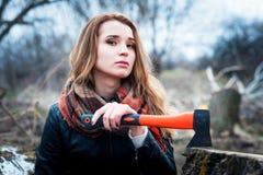 Girl with axe. Stock Photos