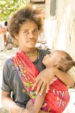 Young girl with baby in sling, Solomon Islands Stock Image