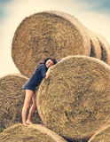 Young  girl on a background of haystack Royalty Free Stock Photo