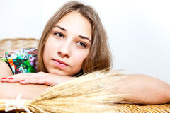 Young girl on background of wheat ears Royalty Free Stock Photography