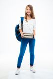Young girl with backpack and books Royalty Free Stock Photos