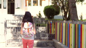 Young girl with backpack is going back to school stock video