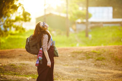 Young girl with backpack Royalty Free Stock Images