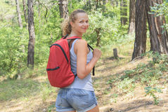 Young girl with a backpack in the tourism campaign Stock Photos