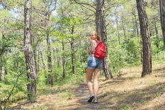 Young girl with a backpack in the tourism campaign Royalty Free Stock Photo