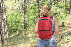 Young girl with a backpack in the tourism campaign Stock Photography