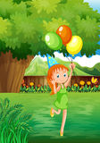 A young girl at the backyard with three balloons Royalty Free Stock Photos