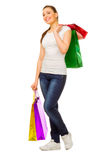 Young girl with bags Stock Images