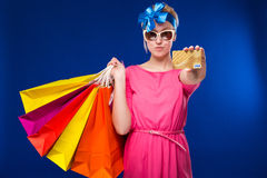 Young girl with bags and credit card in hands Stock Images