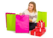 Young girl with bags and gift boxes Stock Photos