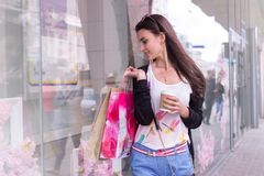 Young girl with bags in hands at the shopping center. Cutie young girl with bags in hands at the shopping center Royalty Free Stock Photo