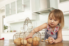 Young Girl Baking Cakes In Kitchen Stock Image