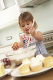 Young Girl Baking Cakes In Kitchen Stock Images