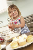 Young Girl Baking Cakes In Kitchen Royalty Free Stock Photography