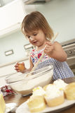 Young Girl Baking Cakes In Kitchen Stock Photography