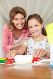 Young girl baking with grandmother at home Royalty Free Stock Photo