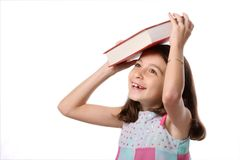 Young Girl Balancing Book on Head Stock Image
