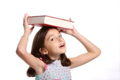 Young Girl balancing book on head Stock Photos