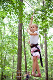 Young girl balancing on rope Stock Image