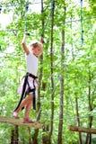 Young girl balancing on rope Stock Photos