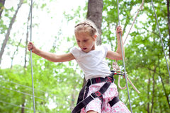 Young girl balancing on rope Stock Images