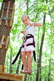 Young girl balancing on rope Stock Photo