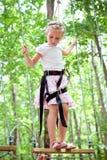 Young girl balancing on rope Stock Image