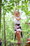 Young girl balancing on rope Stock Photography