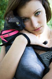 The young girl with a bald cat Stock Photos