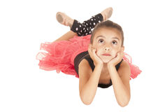 Young girl ballerina laying down looking up. Young Girl ballerina laying down cute expression Royalty Free Stock Photo