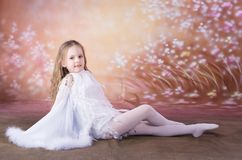 Young girl in ballet long white dress Stock Photos